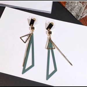 Long statement geometric triangle tassel earrings